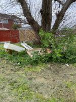 A wooden bed and various other objects appeared under the tree overnight 9/10th April.  image 2-43 Barnwood Close, Reading, RG30 1BY