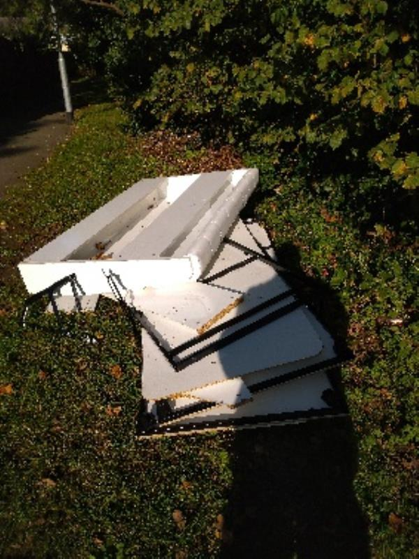Fly tipped wast on the footpath at the back of elevaston way next to E. M Primary school -111 Elvaston Way, Reading, RG30 4NA