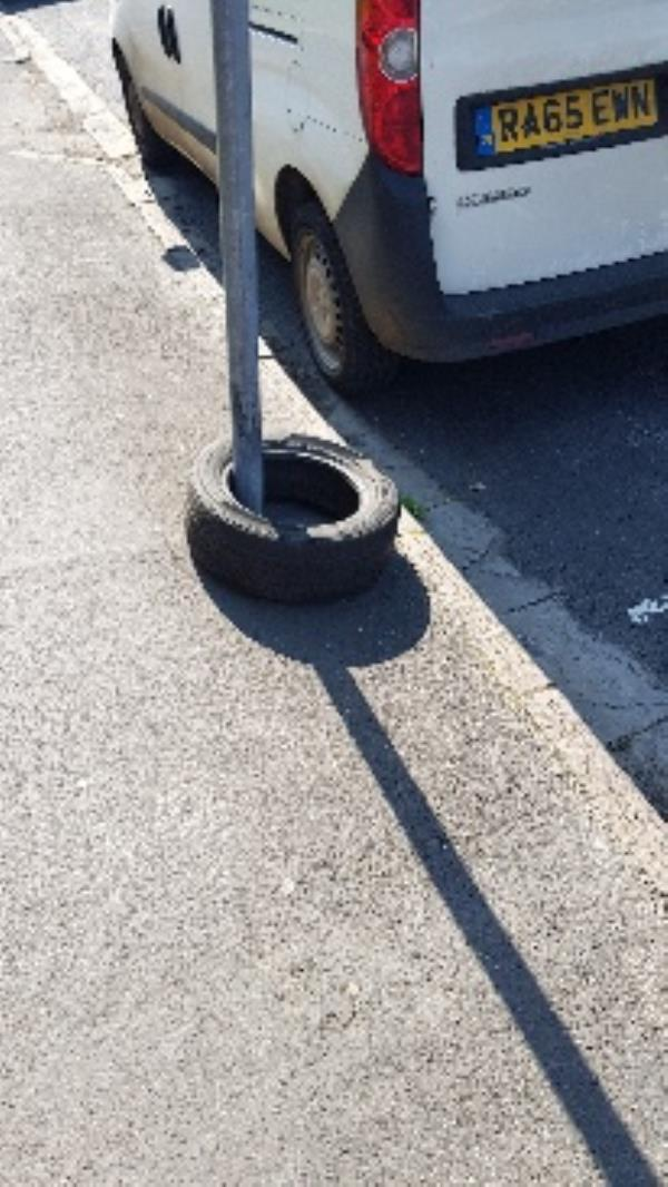 Waste car/van tyre hooped over street parking sign outside flat 5 at 33 Edinburgh Road-33 Edinburgh Road, Reading, RG30 2UA