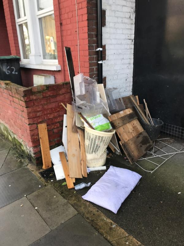 Tons of dumped rubbish that hasn't been cleared. Clearly you guys think it's not your responsibility as it's not on the pavement. Don't be like that - just clear it up -29 Dowsett Road, London, N17 9DA