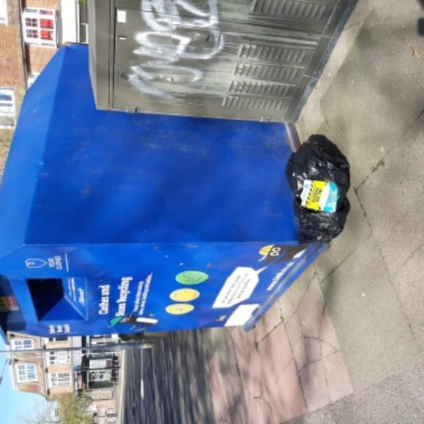 SEESL 06/04/20 @ 3.40PM. FLY-TIP of black bag clothes dumped next to clothing container at Green Street Recycling Site. Please remove. Thanks -149 Green Street, Eastbourne, BN21 1SB