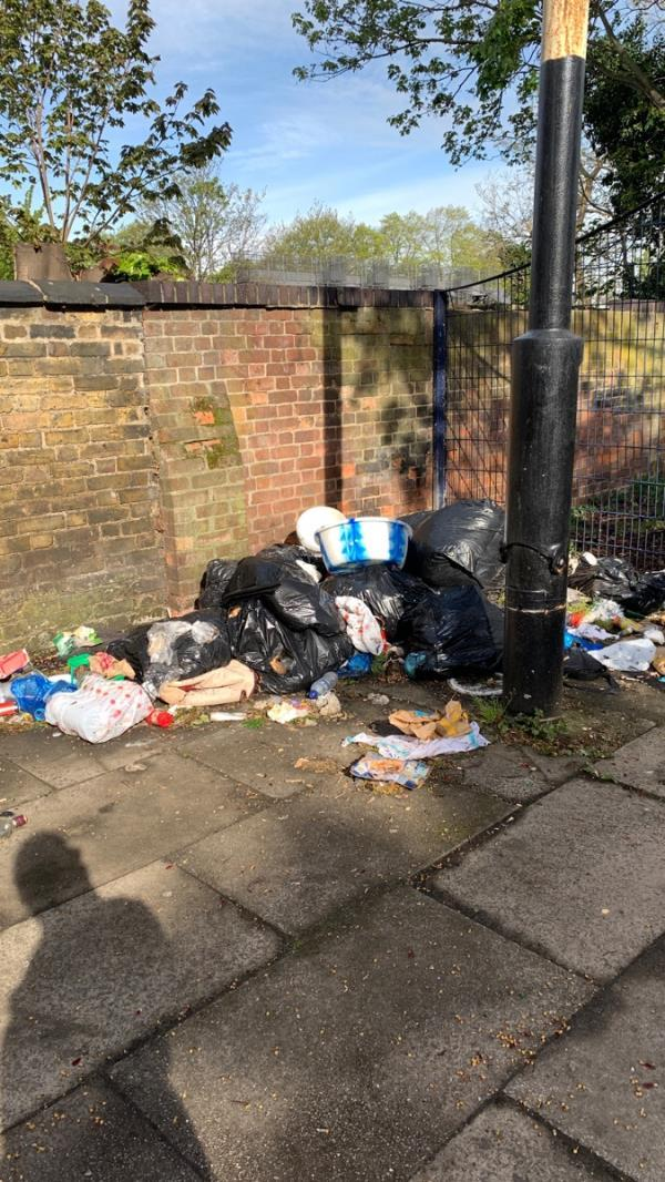 Usual rubbish dumped in the usual location by the footbridge -115 Earlham Grove, London, E7 9AP