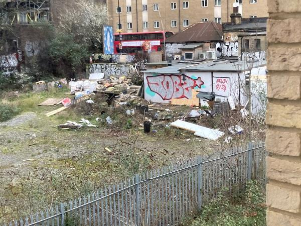 Large amount of household/garden waste, furniture, miscellaneous items (sofas, tables, cupboards, chemical/paint tins, dumped in the area close to New Cross Gate train station behind the shops on New Cross Road. As seen from the photos, this has built up over a long period of time and is clearly not safe. There are several food shops on this road and this fly-tipping is attracting vermin. For public health and safety, please could you arrange to inspect and clear. Thank you.  image 1-265a New Cross Rd, New Cross, London SE14 6AR, UK