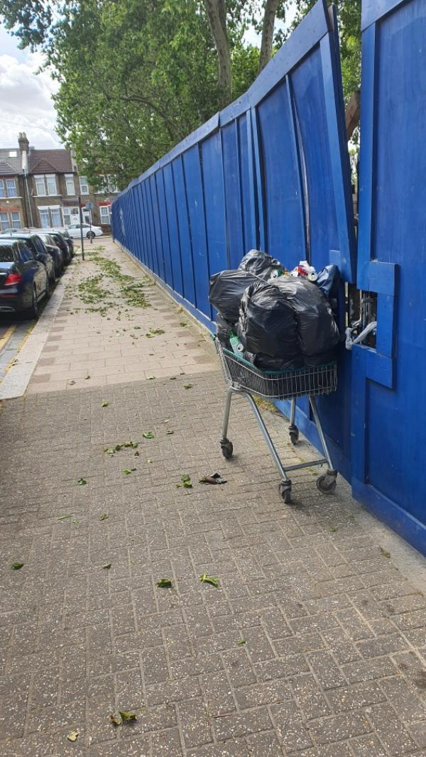 shopping trolley filled with rubbish bags -2 Bishops Avenue, London, E13 0RB