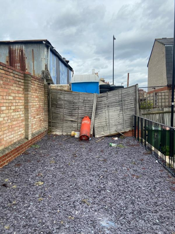 Someone have done some fly tipping in the communal area of the council houses. It can cause toxic harm and danger to children playing in the area. -2b New Barn Street, London, E13 8JA