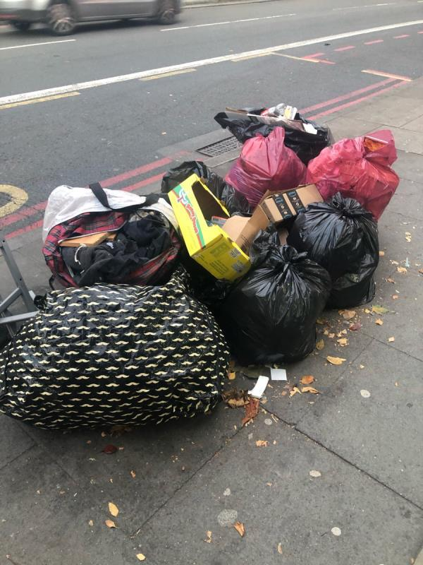 "Large amount of household items, rubbish bags dumped on the pavement by bus stop ""M Belmont Hill"" blocking the public walkway - pedestrians, prams, wheelchairs etc. Please could you arrange to clear. Many thanks. -27 Lee High Road, London, SE13 5NS"