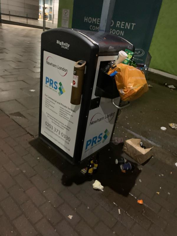 Bins overflowing outside pontoon dock DLR-North Woolwich Road, London, E16 2HP
