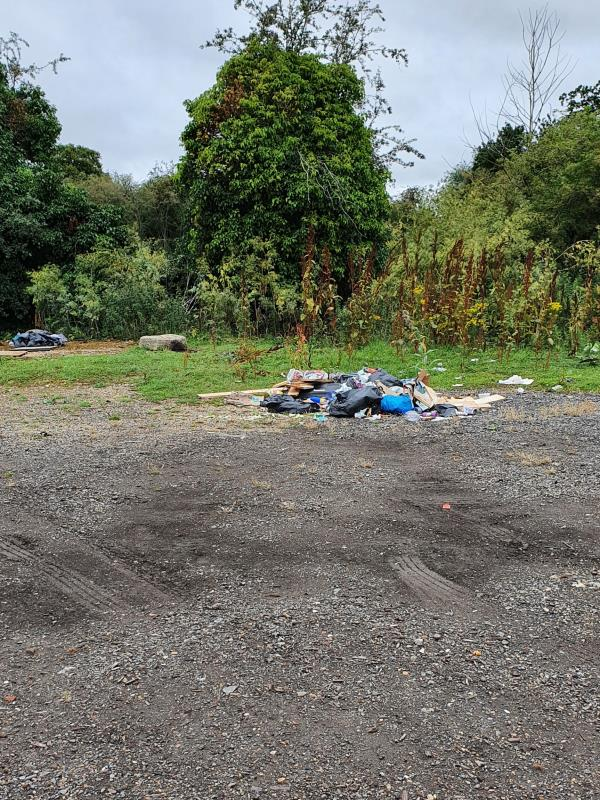 Large amount of mixed rubbish dumped in gravel area behind garden centre. Lots of tyre tracks around too. -Administration Office, 101 Cow Lane, Reading, RG1 8FN