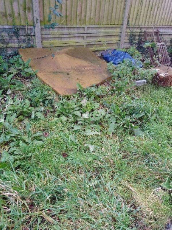 fly tipping front communal garden -at side of block 26-28 spring Terrace-26 Spring Terrace, Reading, RG2 0BD