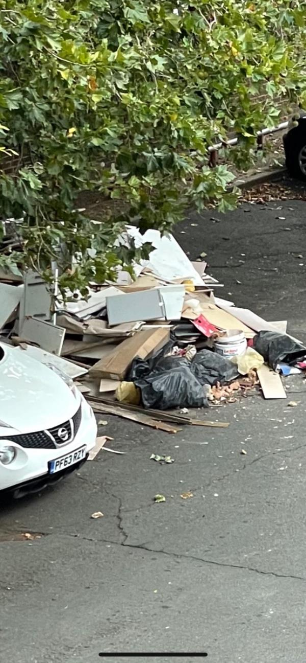 Huge fly tip dumped opposite the garages, near to Kennedy Cox House-21 Lawrence St, London E16 1ER, UK