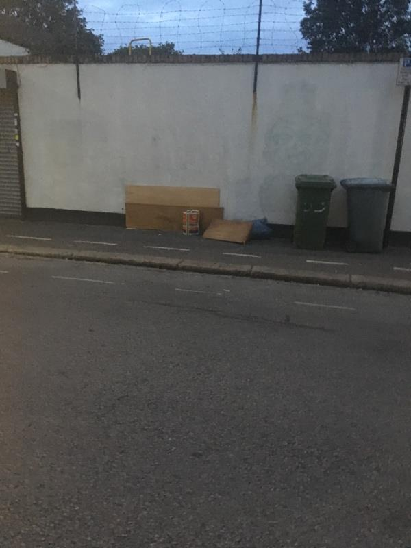 Oil drum and cardboard dumped next to corner shop-58 Field Road, London, E7 9DP