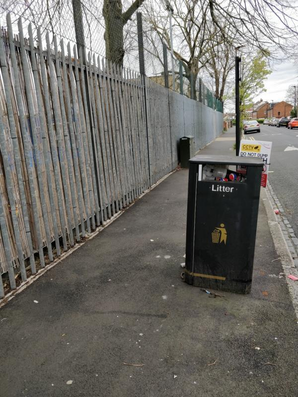 Overflowing litter Bin along the boundary fence of Maryland School on Buxton Road-64 Buxton Road, London, E15 1QU