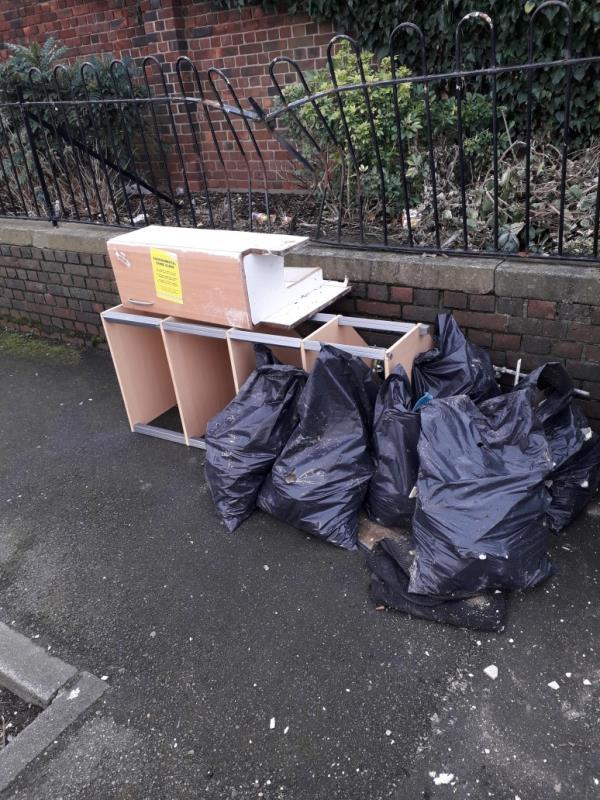 6 x black bags with building materials and wooden unit -38 Kent Street, London, E13 8RL