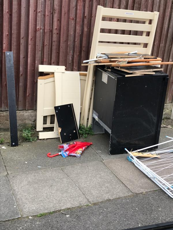 East mobile remove all wood etc opposite no.92 Albacore Crescent -50 Felday Road, Lewisham, SE13 7HJ