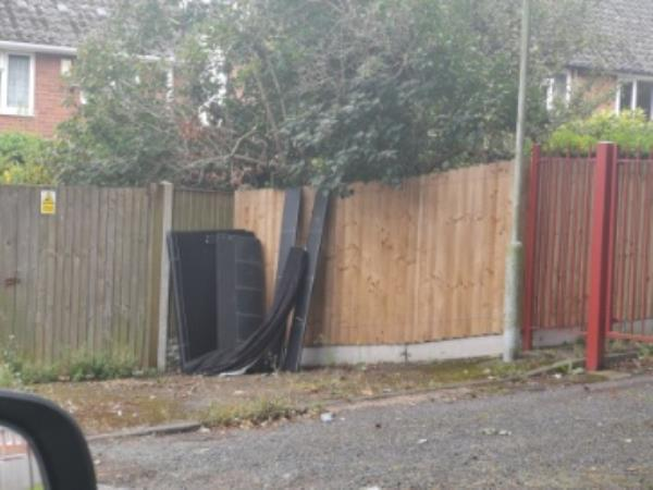 Dismantled bed flytipped by garage entrance -2 Hackett Close, Wolverhampton, WV14 9SB