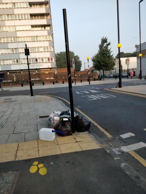 Dumped black bags of rubbish on the pavement at the corner of Buxton and Leytonstone Road E15-60 Leytonstone Road, London, E15 1SQ