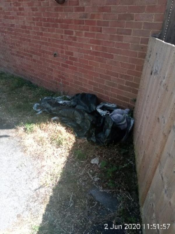 On both sides of the alley  between 128 and 130 windermere Road there is bits of rubbish -4 Windermere Close, Reading, RG2 7BS