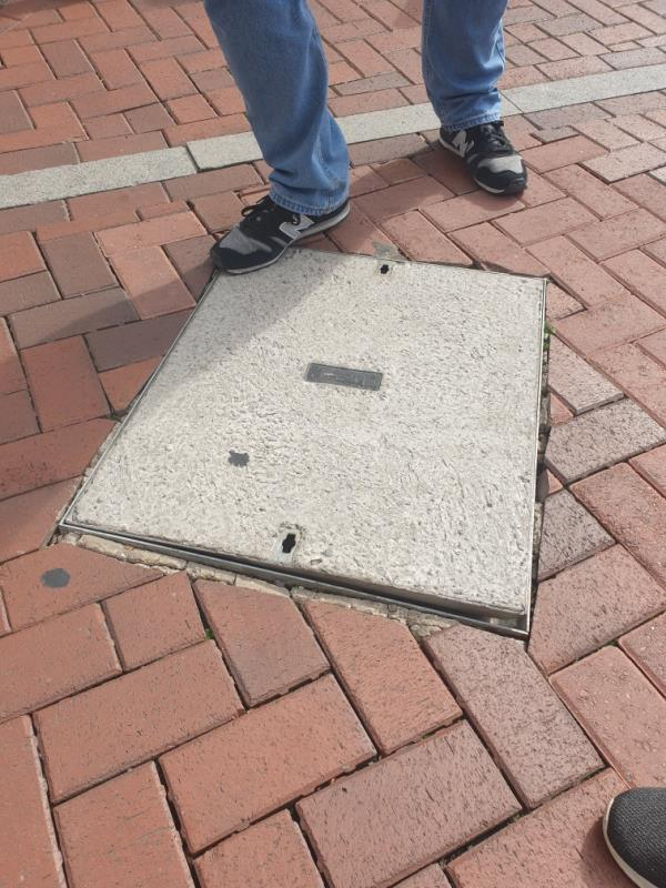 This cover is loose and is moving a lot,even when people aren't treading on it - it is rising up just by catching in the wind and when it does its a few cm up in the air and could cause a trip hazard -51 Friar Street, Reading, RG1 1EP