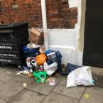 Rubbish dumped next to bins outside The Clapton Table. -159 Lower Clapton Road, London, E5 8EQ