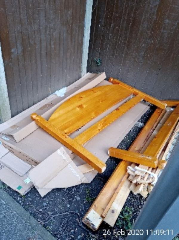 Please can the bed frame bits be cleared from the bin area of block 146-156-4 Cornwood Gardens, Reading, RG2 7LE