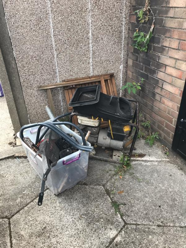 Looks like an old generator, a plastic box of what looks like old car parts and an wooden table. All outside electricity sub station in Evesham Road  image 1-12 Evesham Road, London, E15 4AL