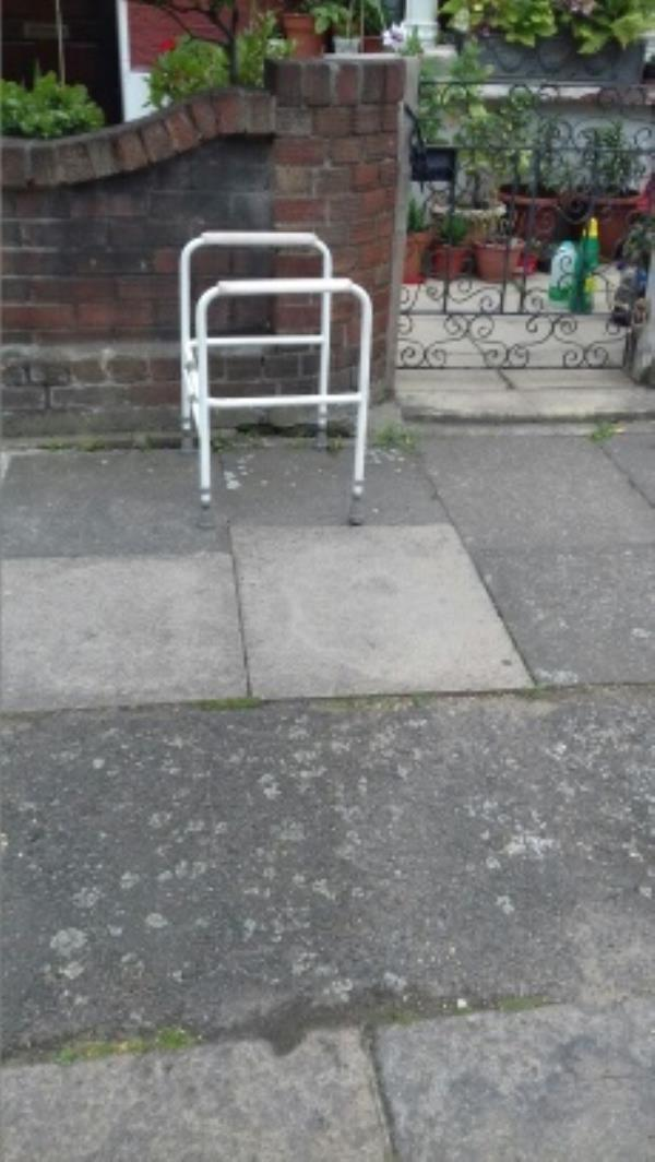 A commode frame dumped outside 16 Patrick Road -14 Patrick Road, London, E13 9QA