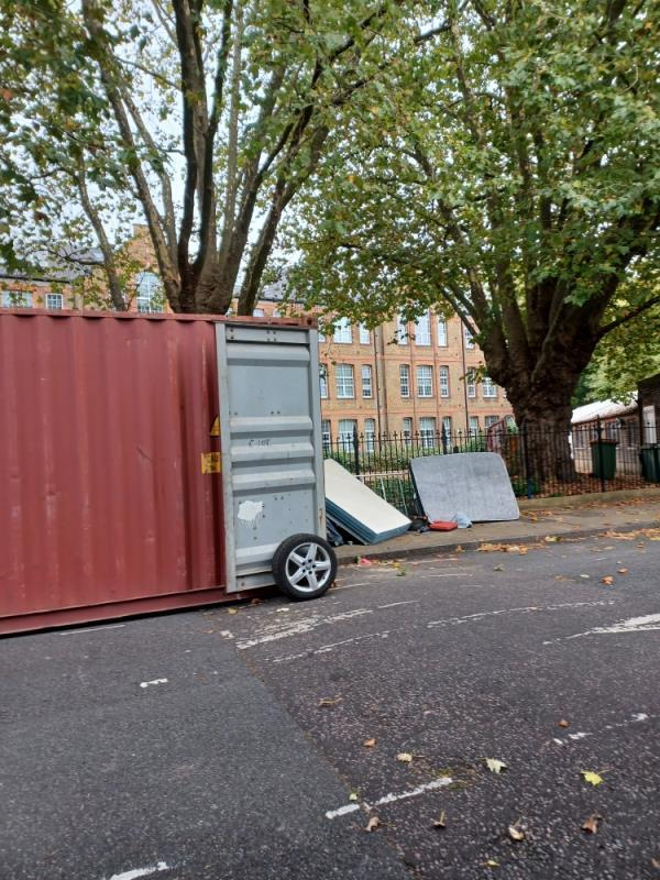 I think this container is dumping lots and lots of rubbish on Bull Road. I can see rubbish inside it but I cannot take a photo because there is a man inside and I don't feel safe.-27 Bull Rd, London E15 3HQ, UK