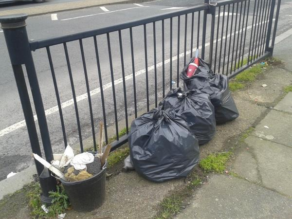 By Hedge Walk. Clear bags of domestic waste-151 Southend Ln, London SE6 3RP, UK