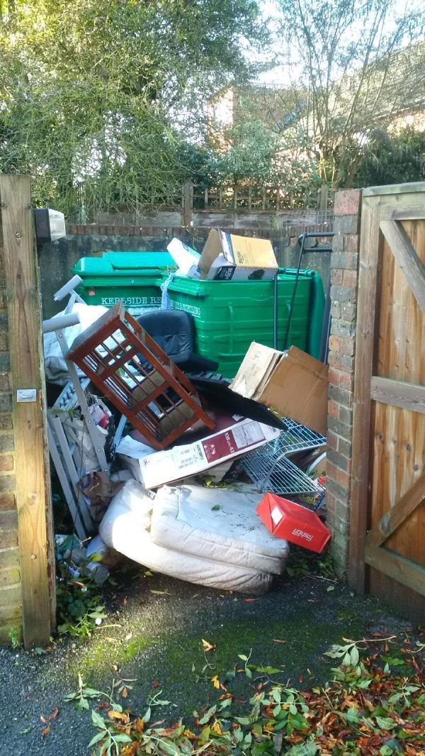 Bin store at ISIS court has had lock broken off and large amount of fly tipping has occured-isis court