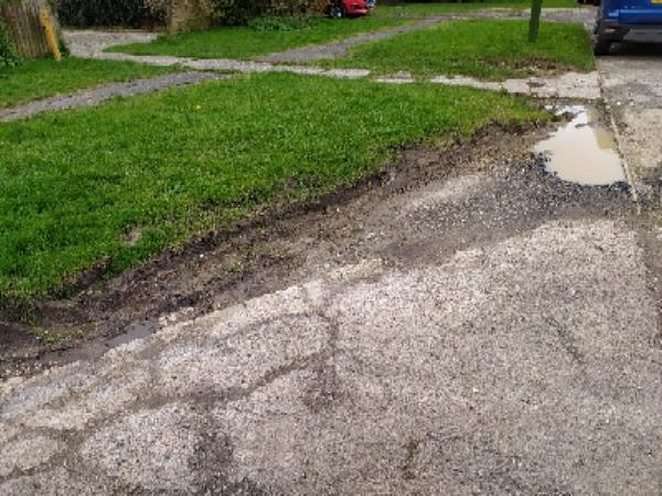 damaged driveway and churned up grass verge from vehicles-44 Weald Close, Hurstpierpoint, BN6 9SR