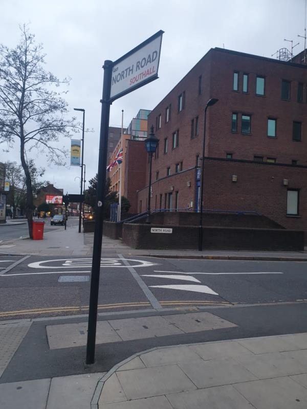 North Rd Road name plate facing wrong way. needs tightening up and realigning. -75 High Street, London, UB1 3HP