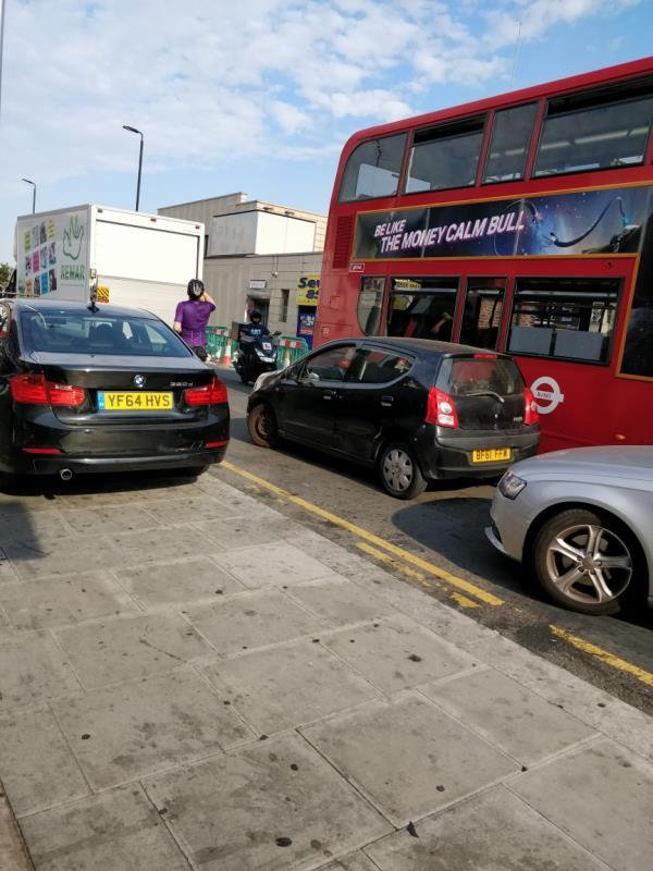 Car illegally parked on the pavement at 23 Leytonstone Road E15-19 Leytonstone Road, London, E15 1JA