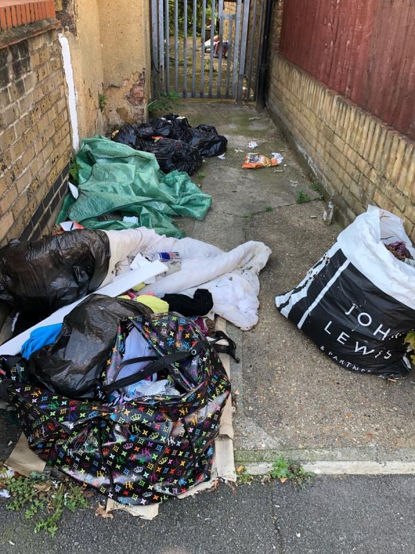 This has been previously reported still pending to be collected. Excuse given no access! It's on the main road each day more items are being added  Location is 140 new barn st by the alleyway  -144 New Barn St, London E13 8JW, UK