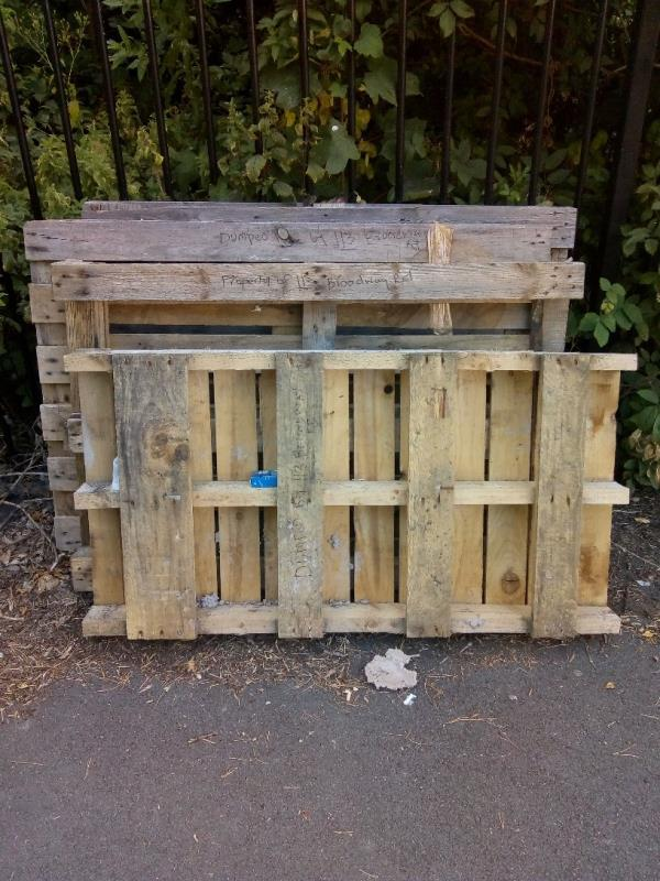 4 pallets with writing on them 'dumped here by 113 Broadway Rd'-93 Highway Road, Leicester, LE5 5RF
