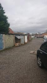 Garage waste spilling out due to broken door image 1-19 Dalkeith Road, Leicester, LE4 7NP