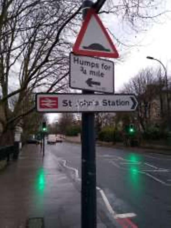 Remove graffiti from St John's station sign-287a Lewisham Way, Honor Oak Park, SE4 1XL