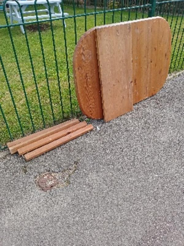 please remove fly tipping front of 10-20 Gainsborough Rd-2a Virginia Way, Reading, RG30 3QH