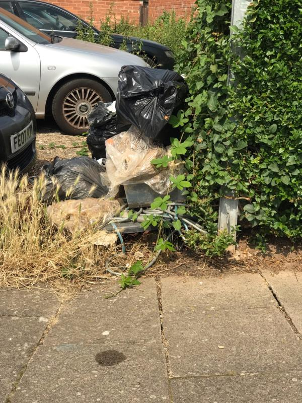Numerous bags of rubbish dumped on the car park area-16 Blissett Road, Leicester, LE3 9HG