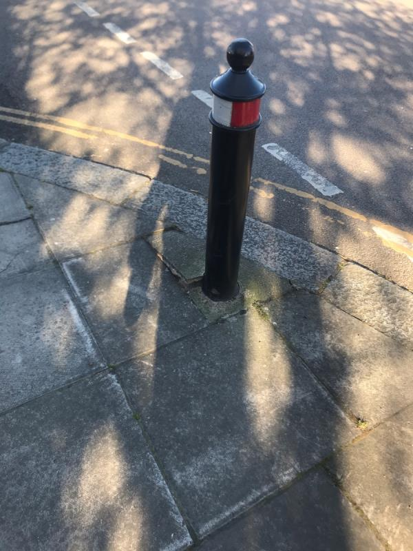 Damaged pavement and leaning bollard are located on Goring Way junction Ferrymead Gardens ub6 -45a Ferrymead Gardens, Greenford, UB6 9NF
