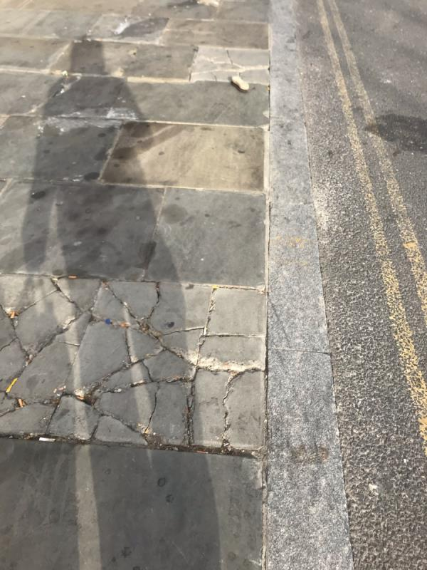 Broken uneven pavement is located outside GDC paint 318 Ruislip Road East ub6- this is due to persistent vans loading /unloading / parking at the location. Please can cycle stands or bollards be installed. Can york stone pavement please be used to replace broken pavement -314a Ruislip Road East, Greenford, UB6 9BH
