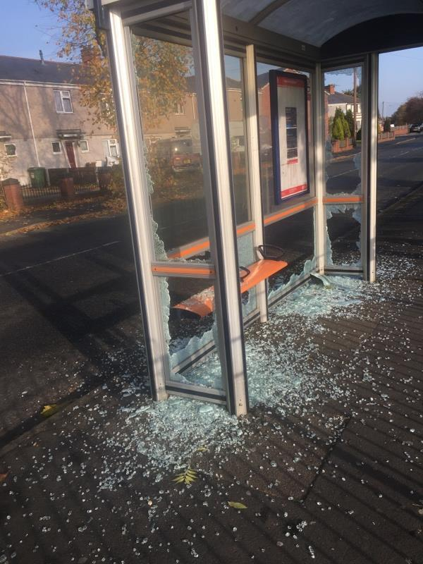 Bus shelter smashed up across road to 106 lunt road. Glass on pavement and on road need cleaning up as soon as possible-Vulcan Road, Wolverhampton, WV14 7HF