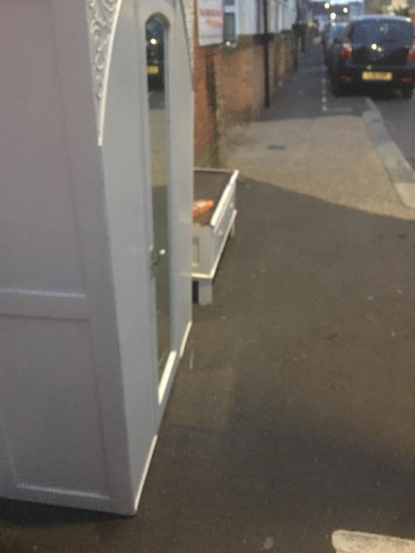 Chest of drawers and wardrobe dumped on footpath -27b Station Road, London, E7 0ES