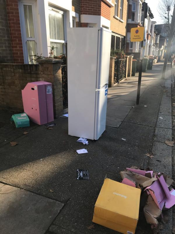 Fridge and boxes discarded in centre of pavement. Blocking pedestrian access and fly tipping-166 Third Avenue, London, E12 6DT