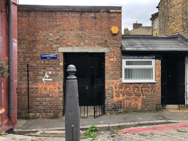 Remove graffiti from wall-14b Havelock Walk, London, SE23 3HG