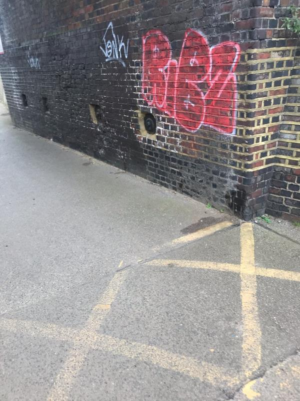 Spray painted tags are located on a brick wall under a railway bridge end of Stockdove Way ub6-24 Stockdove Way, London, UB6 8TJ