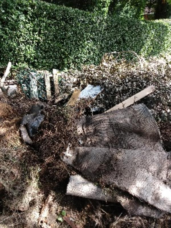 a huge heap of green waste, carpets, plastic items, wood etc has been flytipped in Victoria Rd by the cemetery hedge-22 Victoria Road, Reading, RG4 7QY
