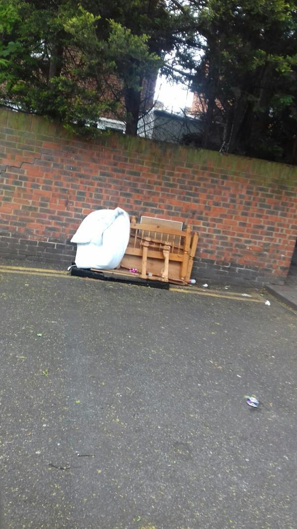 A dismantled bed frame and a quilt dumped near 10 Chargeable Street E16 -12 Chargeable Street, Plaistow, E16 4JZ