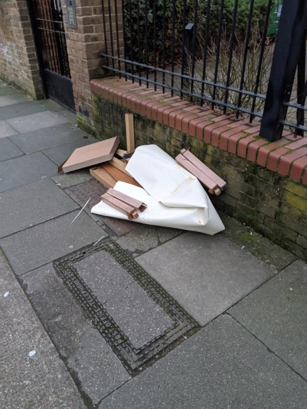 dumped furniture outside Laburnums flats -185 Roman Road, London, E6 3SP