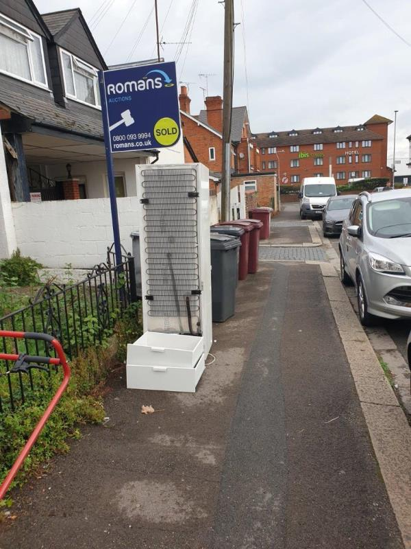 A large fridge freezer has been dumped outside this empty property -4 St George's Road