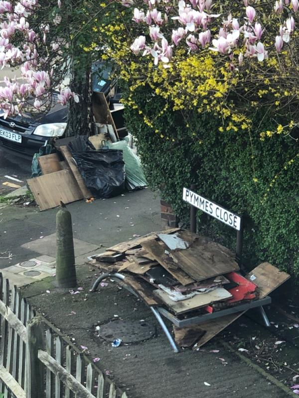 Yet another dump of rubbish. Both under the tree and at the end of Pymmes Close path. -Crowhurst Court Lansdowne Road, London, N17 9XZ